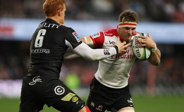 Philip van der Walt (captain) of the Sharks tackling Jaco Kriel (captain) of the Emirates Lions during a Super Rugby match