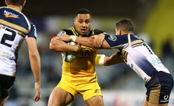 Ngani Laumape of the Hurricanes is tackled during the Super Rugby Quarter Final