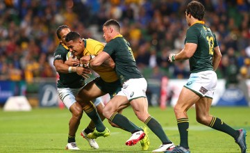 Israel Folau of Australia looks to break from a tackle by Courtnall Skosan and Jesse Kriel of South Africa during The Rugby Championship match between the Australian Wallabies and the South Africa Springboks at nib Stadium