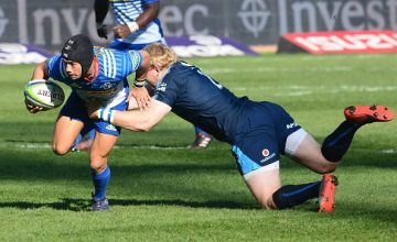 Adriaan Strauss of the Bulls tackles Cheslin Kolbe of the Stormers during the Super Rugby match between Vodacom Bulls and DHL Stormers