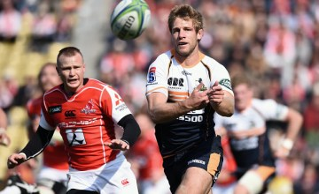 Kyle Godwin of the Brumbies passes the ball during the Super Rugby round 2 match between Sunwolves and Brumbies