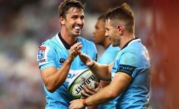 Jake Gordon and Bernard Foley of the Waratahs high five during the round two Super Rugby match between the Waratahs and the Stormers