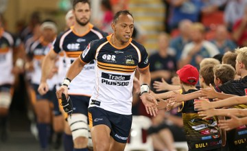 Christian Lealiifano of the Brumbies runs out with his team during round two of the Super Rugby match