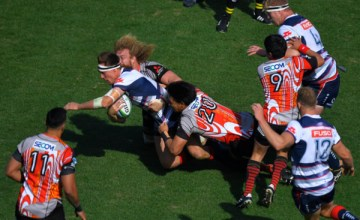 Willem Britz #5 of Sunwolves makes a tackle on Jack Maddocks #14 of Rebels during the Super Rugby round 3 match