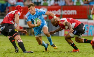Johnny Kotze of the Bulls and Lionel Mapoe of the Lions during the Super Rugby match between Bulls and Lions