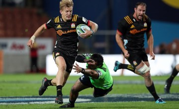 Damien Mckenzie with the Super Rugby ball for the Chiefs