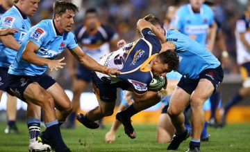 Thomas Banks of the Brumbies is tackled during the round seven Super Rugby match between the Brumbies and the Waratahs at GIO Stadium
