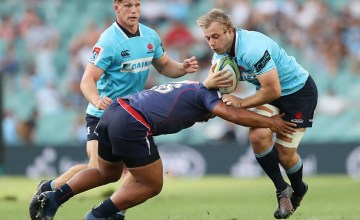 Will Miller of the Waratahs is tackled during the round five Super Rugby match between the Waratahs and the Rebels at Allianz Stadium