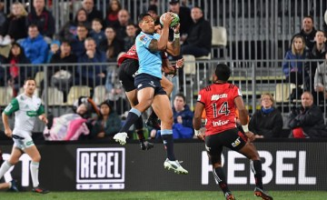 Israel Folau of the Waratahs charges forward during the round 12 Super Rugby match between the Crusaders and the Waratahs
