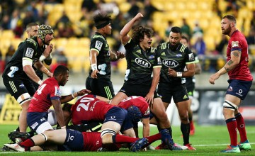 Peter Umaga-Jensen of the Hurricanes celebrates the try of teammate Jordie Barrett during the round 14 Super Rugby match between the Hurricanes and the Reds