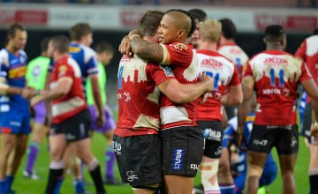 Elton Jantjies of the Lions and team mates celebrate during the Super Rugby match between DHL Stormers and Emirates Lions