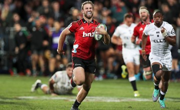 Braydon Ennor of the Crusaders breaks away to score a try during the Super Rugby Qualifying Final match between the Crusaders and the Sharks