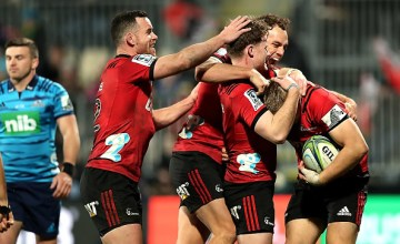 Ryan Crotty, Israel Dagg, Mitchell Drummond and Jack Goodhue all of the Crusaders celebrate after scoring a try during the round 19 Super Rugby match between the Crusaders and the Blues at AMI Stadium