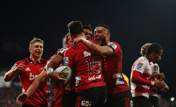 Seta Tamanivalu of the Crusaders celebrates after scoring a try with David Havili and Bryn Hall of the Crusaders during the Super Rugby Final