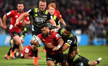 Richie Mo'unga of the Crusaders dives over to score a try during the round two Super Rugby match between the Crusaders and the Hurricanes at Christchurch Stadium