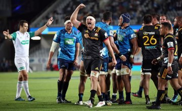 Mitchell Brown of the Chiefs (C) celebrates the final whistle during the round two Super Rugby match