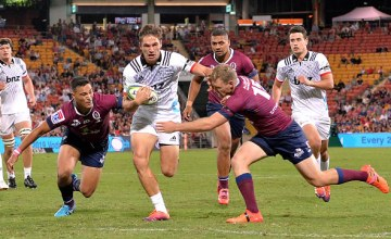 George Bridge of the Crusaders takes on the defence during the round three Super Rugby match between the Reds and the Crusaders at Suncorp Stadium