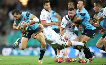 Adam Ashley-Cooper of the Waratahs is tackled during the round six Super Rugby match between the Waratahs and the Crusaders
