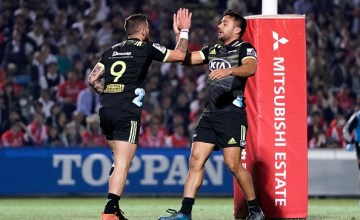 TJ Perenara and Chase Tiatia celebrate the Hurricanes' first try against the Sunwolves in Tokyo, Japan
