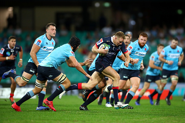 Reece Hodge of the Rebels makes a break during the round 10 Super Rugby match between the Waratahs and the Melbourne Rebels at the Sydney Cricket Ground