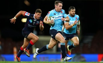 Bernard Foley of the Waratahs makes a break during the round 10 Super Rugby match between the Waratahs and the Melbourne Rebels at the Sydney Cricket Ground