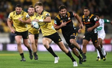Jordie Barrett of the Hurricanes breaks away for a try during the round 11 Super Rugby match between the Hurricanes and Chiefs at Westpac Stadium
