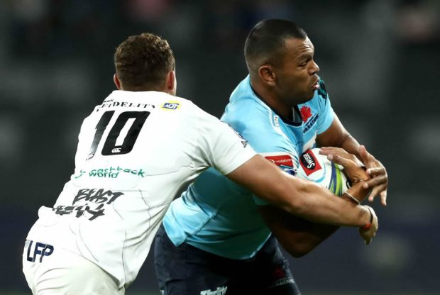 Kurtley Beale of the Waratahs Is tackled during the round 11 Super Rugby match between the Waratahs and Sharks at Bankwest Stadium