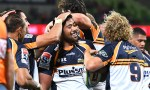 Folau Fainga'a celebrates scoring a hat-trick as the Brumbies beat the Blues in Canberra