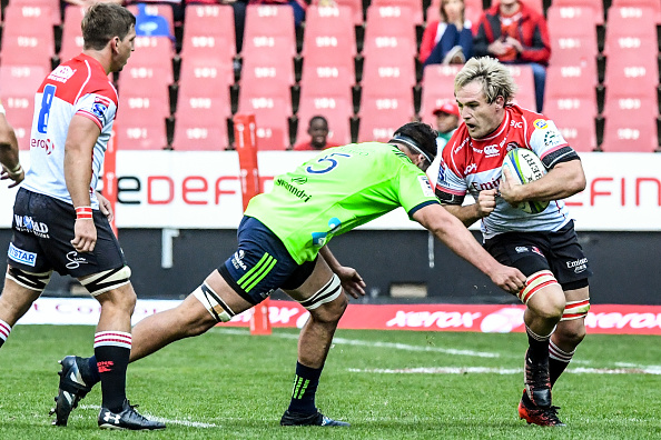 Marnus Schoeman of Lions attempts to avoid a tackle during the Super Rugby match between the Lions and Highlanders at Ellis Park on May 18, 2019 in Johannesburg, South Africa