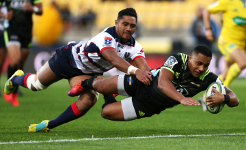 Ngani Laumape of the Hurricanes scores a try in the tackle of Rob Leota of the Rebels during the round 12 Super Rugby match between the Hurricanes and Rebels at Westpac Stadium