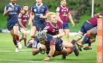Tetera Faulkner scores a try during the round 13 Super Rugby match between the Rebels and the Reds at AMI Park on May 10, 2019 in Melbourne, Australia