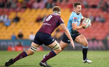 Bernard Foley of the Waratahs runs with the ball during the round 14 Super Rugby match between the Reds and the Waratahs at Suncorp Stadium