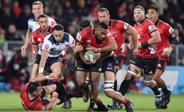 Sevu Reece of the Crusaders is tackled during the round 17 Super Rugby match between the Crusaders and the Rebels at Christchurch Stadium