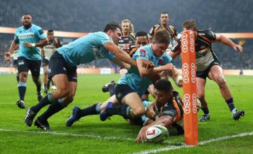 Folau Fainga'a of the Brumbies attempts to score a try in the corner during the round 17 Super Rugby match between the Waratahs and the Brumbies at Bankwest Stadium