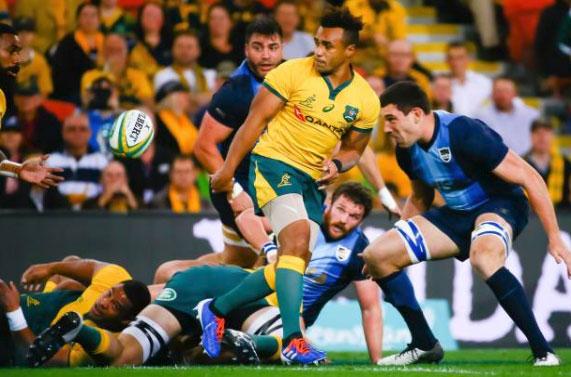 Australia's Will Genia flicks a pass