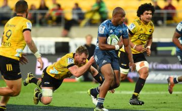 Mark Telea of the Blues makes a run during the round six Super Rugby match between the Hurricanes and the Blues