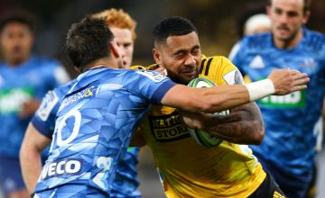 Ngani Laumape of the Hurricanes is tackled by Otere Black of the Blues during the round 6 Super Rugby Aotearoa match between the Hurricanes and the Blues at Sky Stadium
