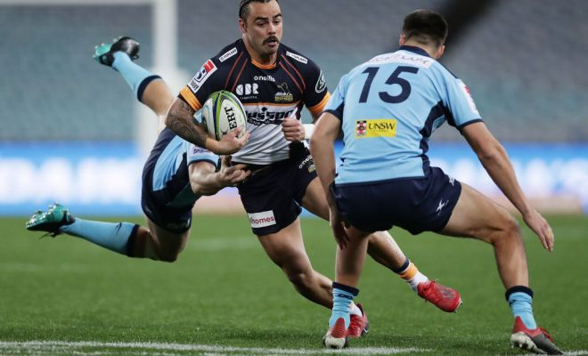 Andy Muirhead of the Brumbies is tackled during the round three Super Rugby AU match between the Waratahs and the Brumbies at ANZ Stadium