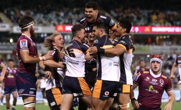 Thomas Banks of the Brumbies celebrates with team mates after scoring a try during the Super Rugby AU Grand Final between the Brumbies and the Reds