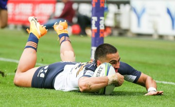 Tom Wright scores for the Brumbies against the Melbourne Rebels in Super Rugby AU Round Nine at AAMI Park, Melbourne.