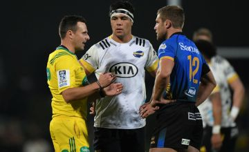 Match referee James Doleman speaks to Reed Prinsep of the Hurricanes and Kyle Godwin of the Western Force during the round three Super Rugby Trans-Tasman match