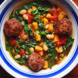 Collard Green, Sweet Potato, and White Bean Soup with Vegan Meatballs