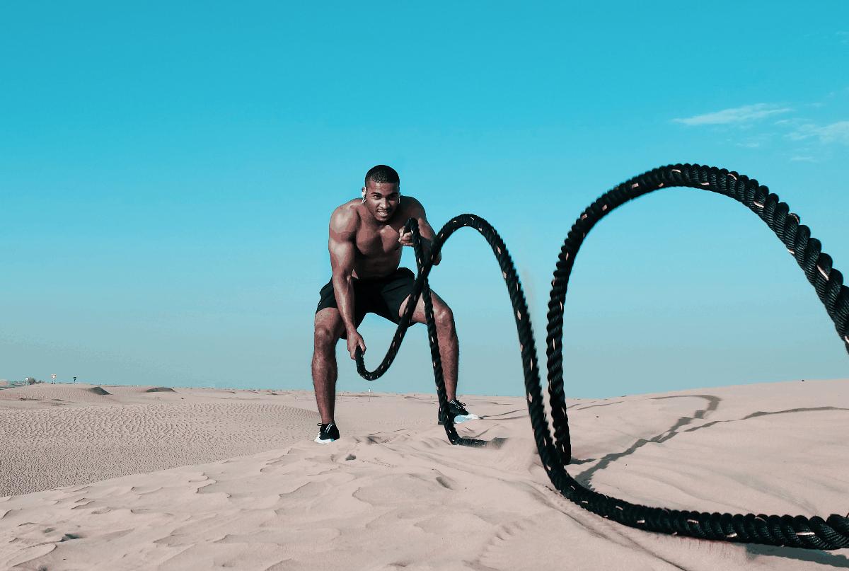 man doing battle ropes