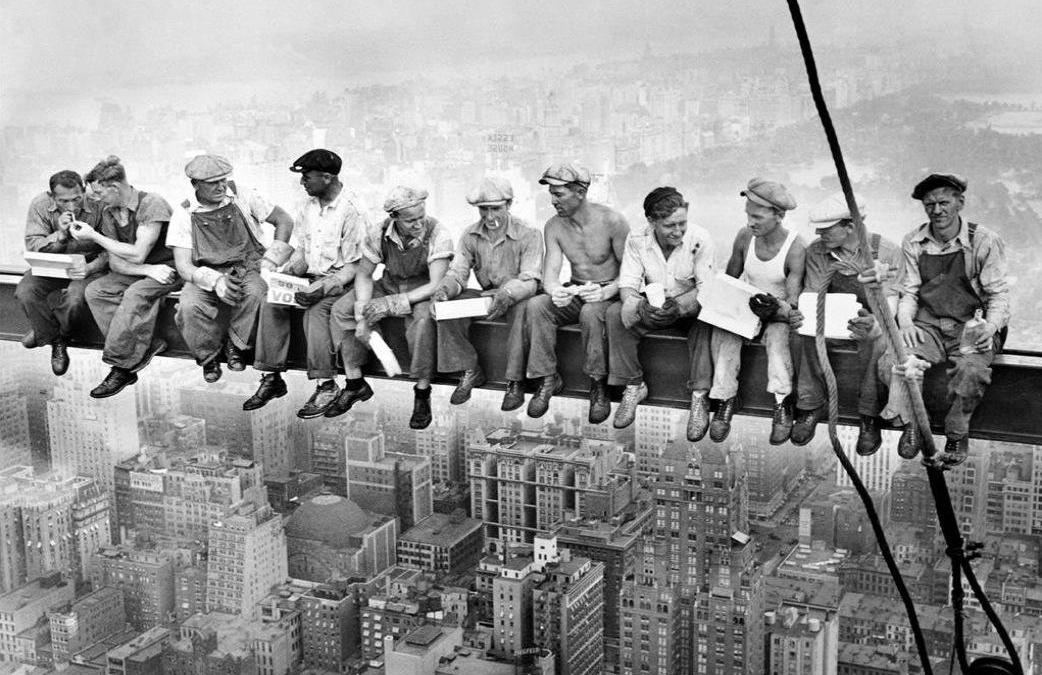 Construction workers in 1932 sit on a crossbeam having lunch during the construction of NYC's RCA Building