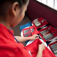 Sala Bai student preparing utensils