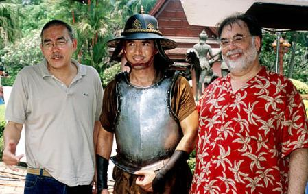 Movie Director Francis Ford Coppola, right, actor Chatchai Plengpanich, middle, and Thai director and Prince  Chatrichalerm Yukol pose for photographs Monday, March 11, 2002 on the set in Ayuthaya. Coppola is in Thailand  to help edit the new version of ''Suriyothai''. The film will be shown in the Thai language with English subtitles. Photo by Mick Elmore