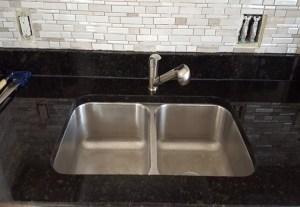double bowl, stainless steel sink, double bowl sink, retattached sink, sink services, sink repair, surface link, granite countertops, granite repairs