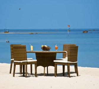 sandy beach with chair and table