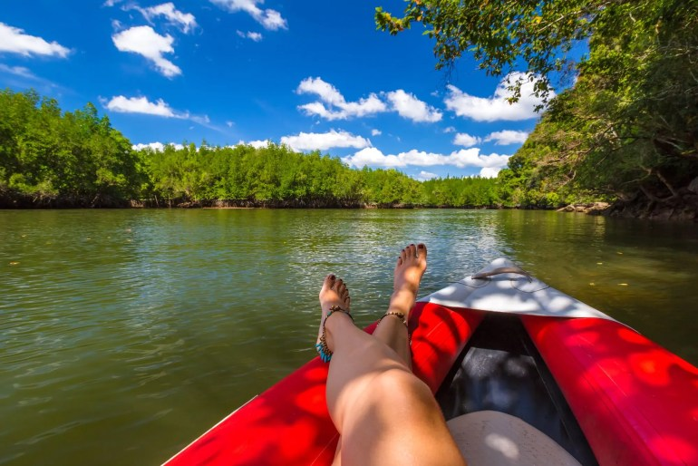 woman relaxing in kayak