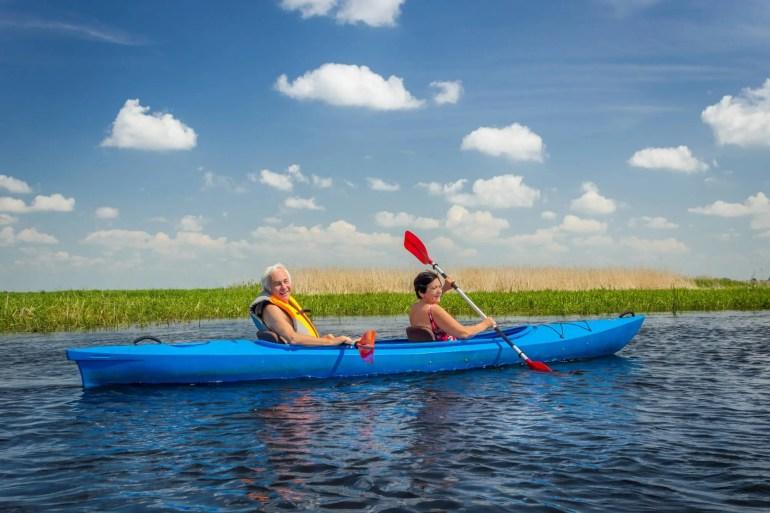 elderly couple in tandem kayak